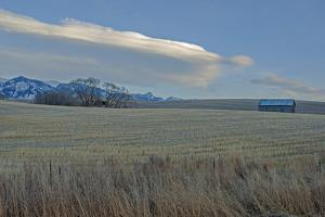 Lenticular Clouds Hover over the Bridger Mountains and Harvested Wheat Fields, Montana by Gordon Wiltsie