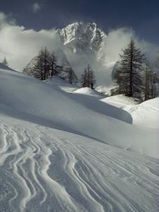 Mount Blanc Partially Obscured by Clouds in Snowy Landscape by Gordon Wiltsie