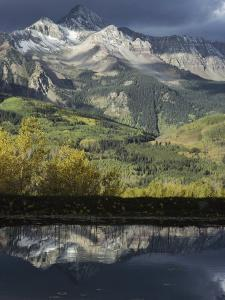 Mount Wilson and the San Juan Mountains Casting Reflections in a Lake by Gordon Wiltsie