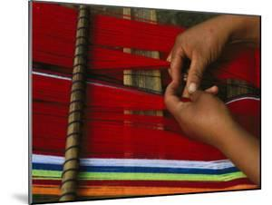 Peruvian Woman Weaving with Colorful Yarn by Gordon Wiltsie