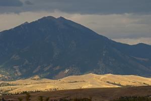 Sunlight Illuminates the Story Hills, Between Bozeman, Montana and the Bridger Mountains by Gordon Wiltsie