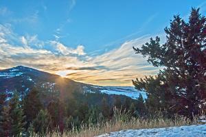 The Sun Sets Behind Mount Ellis in Montana's Gallatin Range of the Rocky Mountains by Gordon Wiltsie