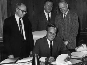 Governor John A. Love Signs the Appropriation Bill