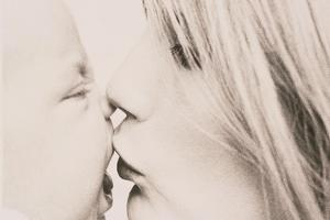 Mother Kissing Baby by Graeme Harris