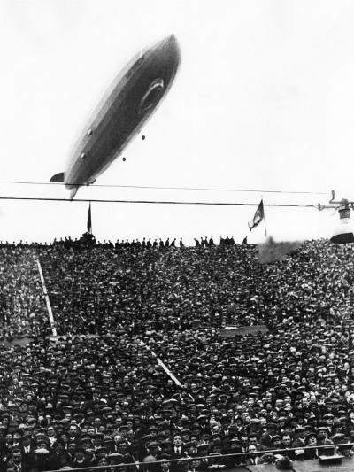 Graf Zeppelin Passing Low over Wembley Stadium During FA Cup Final Where Arsenal Beat Huddersfield--Photographic Print