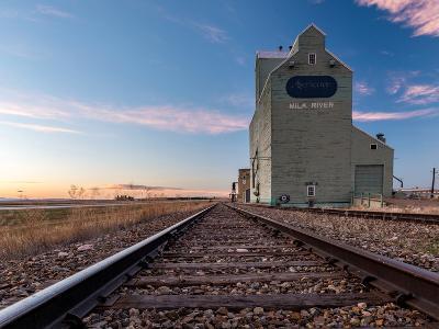 Grain elevator and railroad track, Milk River, Alberta, Canada--Photographic Print