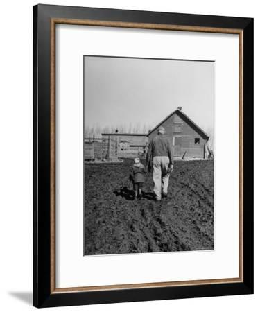 Grandpa and 4 Year Old Granddaughter, on Morning Chores, to Feed Pigs on Nearby Lot-Gordon Parks-Framed Premium Photographic Print