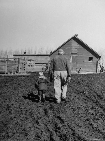 Grandpa and 4 Year Old Granddaughter, on Morning Chores, to Feed Pigs on Nearby Lot-Gordon Parks-Photographic Print
