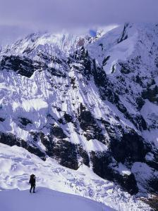 Climber Ascending to Alpamayo High Camp with the Slopes of Pucahirca Massif Beyond, Ancash, Peru by Grant Dixon