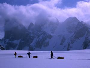 Mt. Asgard Behind Sledding Group on Turner Glacier, Auyuittuq NP, Baffin Island, Nunavut, Canada by Grant Dixon
