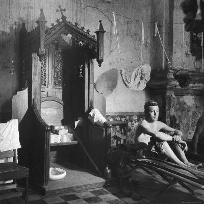Grave Soldier on Cot Next to Ornate Confessional in Makeshift Hospital in Cens Cathedral-W^ Eugene Smith-Photographic Print