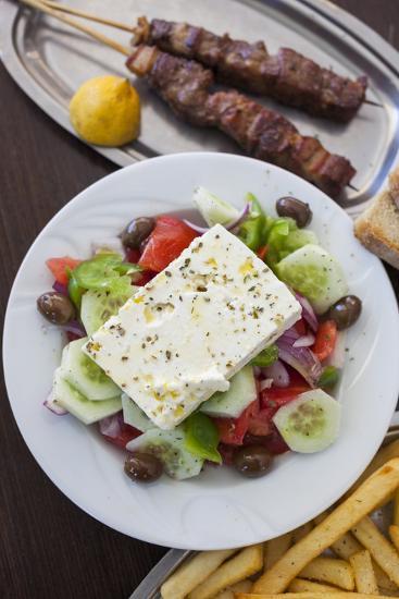 Greece, Peloponnese, Corinth, Greek Salad with Souvlaki and Fries-Walter Bibikow-Photographic Print