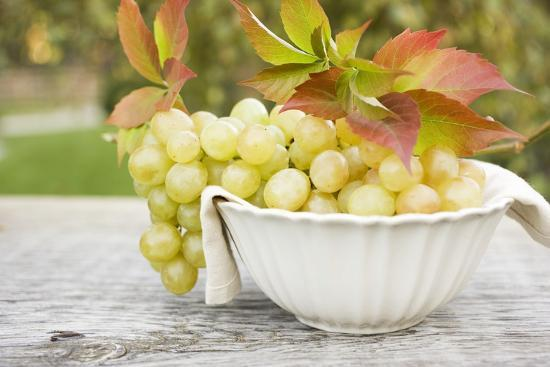 Green Grapes and Autumn Leaves in White Bowl-Foodcollection-Photographic Print