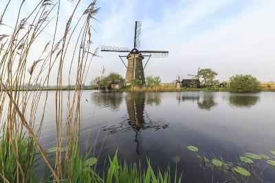 Green Grass Frames the Windmills Reflected in the Canal, Netherlands-Roberto Moiola-Photographic Print