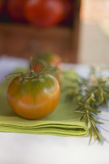 Green Tomatoes on Green Napkin on Table Out of Doors-Foodcollection-Photographic Print