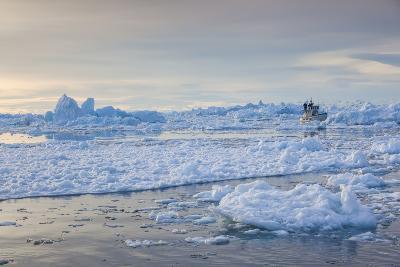 Greenland, Disko Bay, Ilulissat, Fishing Boat in Floating Ice at Sunset-Walter Bibikow-Photographic Print