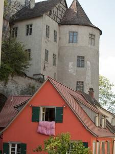 Castle in Town of Meersburg with Orange Home in Foreground by Greg