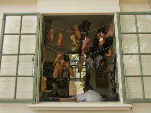 Colonial Shoemaker Works in a Shop with an Open Window by Greg