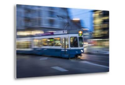 A Blurred Motion View of a Tram at Night in Zurich, Switzerland