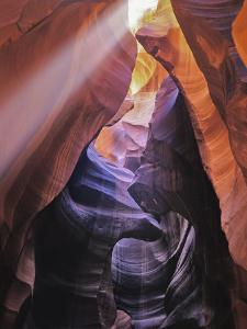 Beam of Light Shining Through Rock Formations in Antelope Canyon by Greg Dale