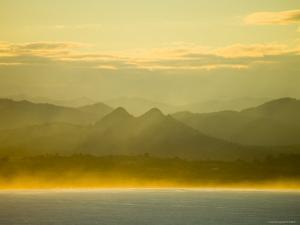 Late Afternoon Sunlight on Byron Bay, with Mount Warning National Park Beyond by Greg Elms