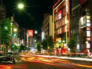 Moving Lights on Street of Roppongi at Night, Tokyo, Japan by Greg Elms