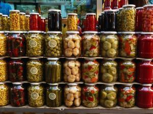 Preserves in Jars Stacked on Shelf, Istanbul, Turkey by Greg Elms