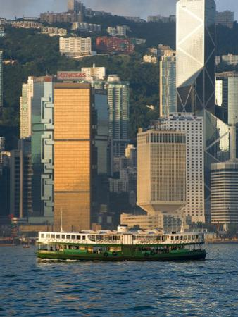 Star Ferry Crossing Hong Kong Harbour with the Towers of Hong Kong Island Beyond, Hong Kong, China