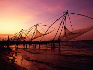 Traditional Fishing Nets at Sunset, Kochi, Kerala, India by Greg Elms