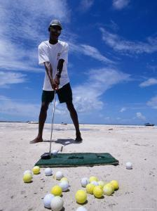 Bahamian Golfer Tees Up on the Pink Sand, Pink Sands Beach, Harbour Island, Bahamas by Greg Johnston
