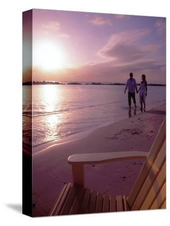 Couple Walking Along Beach at Sunset, Nassau, Bahamas, Caribbean