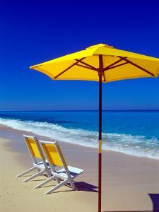 Yellow Chairs and Umbrella on Pristine Beach, Caribbean by Greg Johnston