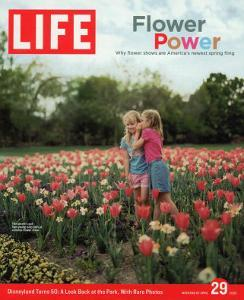 Two Girls Sharing a Secret Standing in Tulip Beds at a Dallas Flower Show, April 29, 2005 by Greg Miller