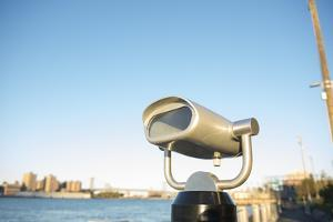 Coin operated binoculars facing the Manhattan Bridge, New York City, New York by Greg Probst