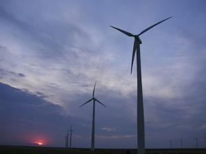 Wind Turbines Silhouetted Against Sunset in Kansas by Greg