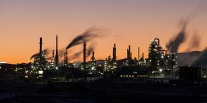 A time exposure of the Sinclair gas refinery. by Greg Winston