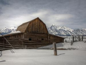 An Old Log Barn in Front of the Teton Range by Greg Winston