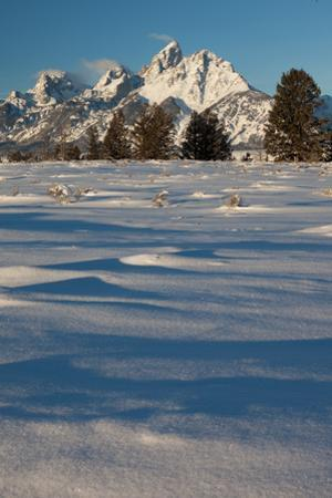 Clouds Drift In The Teton Mountain Range In Front Of Fresh Snow Just After A Winter Sunrise by Greg Winston