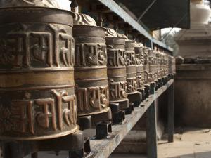 Prayer Wheels Near a Stupa in Kathmandu, Nepal by Greg Winston