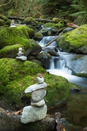Stone Cairns Near a Stream in the Columbia River Gorge National Scenic Area by Greg Winston