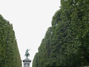 Equestrian statue between trees, Paris, France by Gregor Schuster