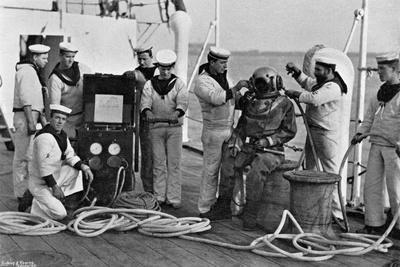 Diver and His Apparatus on Board HMS Blake, 1896