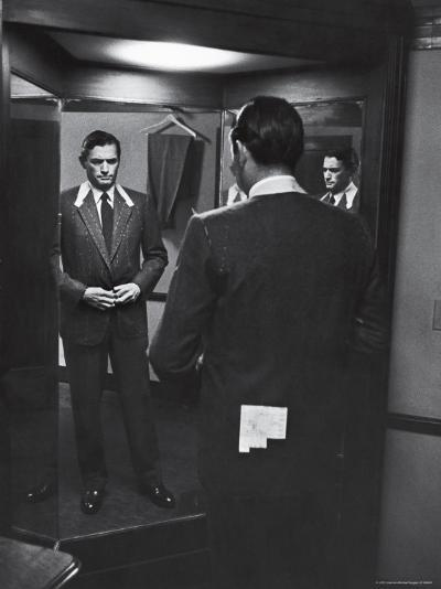 Gregory Peck Trying on Suit for His New Movie Man in the Grey Flannel Suit-Michael Rougier-Premium Photographic Print
