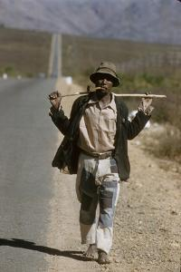 African Man Walks Along Side of Road, Durban, South Africa, 1960 by Grey Villet