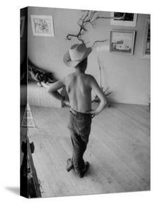 Boy Viewing Local Art Exhibit by Grey Villet
