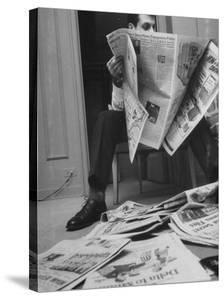 Comedian Mort Sahl at Home Reading Newspaper by Grey Villet