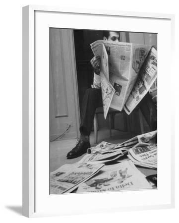 Comedian Mort Sahl at Home Reading Newspaper