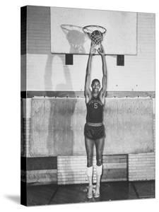 """Overbrook Highschool Basketball Team, Wilt """"The Stilt"""" Chamberlain Touch Basket at Regular Standing by Grey Villet"""