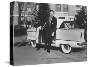 President of American Motors George W. Romney Getting Out of His Car by Grey Villet