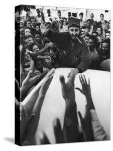 Rebel Leader Fidel Castro Being Cheered by a Village Crowd on His Victorious March to Havana by Grey Villet